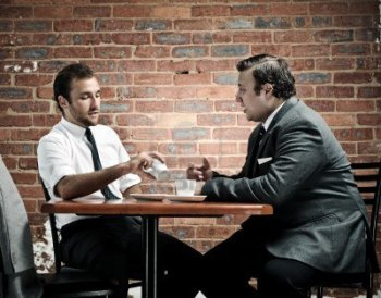 8726485-discussion-in-a-coffee-shop-by-two-vintage-businessmen