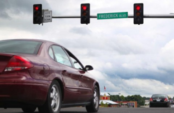 car at stop light-resized-600